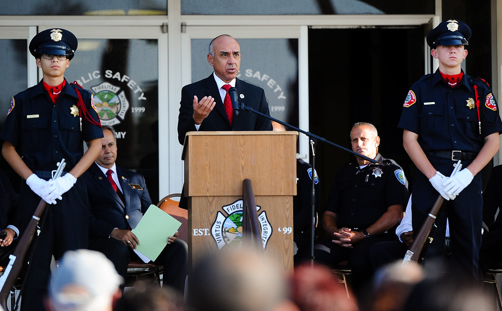 Description of . San Bernardino County District Attorney Michael Ramos speaks during a 9/11 remembrance ceremony at the Public Safety Academy in San Bernardino on Wednesday, Sept. 11, 2013. San Bernardino City Mayor Patrick Morris, San Bernardino County Supervisor James Ramos and other dignitaries spoke during the event. (Photo by Rachel Luna / San Bernardino Sun)(Photo by Rachel Luna / San Bernardino Sun)