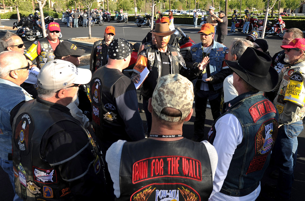Description of . Marine veteran Ryan Kendall (center) of Vista, Ca., talks with a group of Run For The Wall (RFTW) riders, before leaving  Victoria Gardens in Rancho Cucamonga, Ca., and heading to the Vietnam Memorial Wall in Washington D.C., May 14, 2014. (Photo by John Valenzuela/Inland Valley Daily Bulletin)