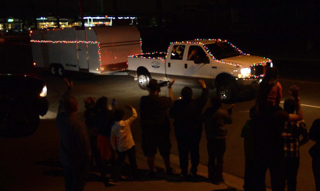 Description of . The Community Ho Ho Parade up parade through the Street of San Bernardino Tuesday night December 17, 2013 in San Bernardino.LaFonzo Carter/ Staff Photographer