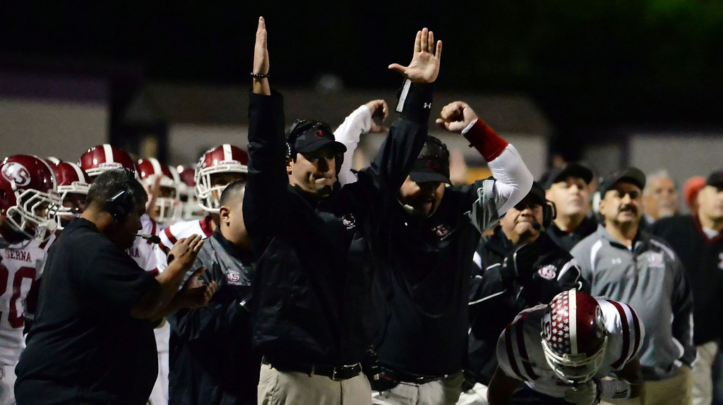 Description of . La Serna bench reacts after a Bryce Oliver (not pictured) touchdown in the first half of a CIF-SS playoff football game against Diamond Bar at Diamond Bar High School in Diamond Bar, Calif., on Friday, Nov. 22, 2013.   (Keith Birmingham Pasadena Star-News)