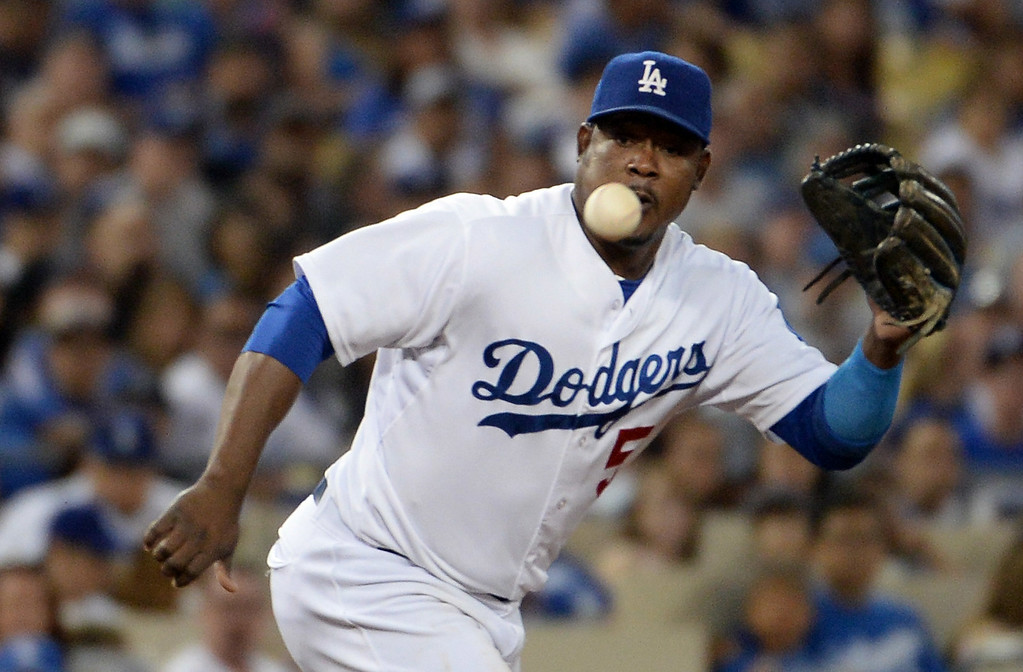 Description of . Los Angeles Dodgers third baseman Juan Uribe makes the play on a ground ball by San Diego Padres' Rene Rivera (not pictured) in the  fifth inning of a Major league baseball game on Saturday, July 12, 2014 in Los Angeles.   (Keith Birmingham/Pasadena Star-News)