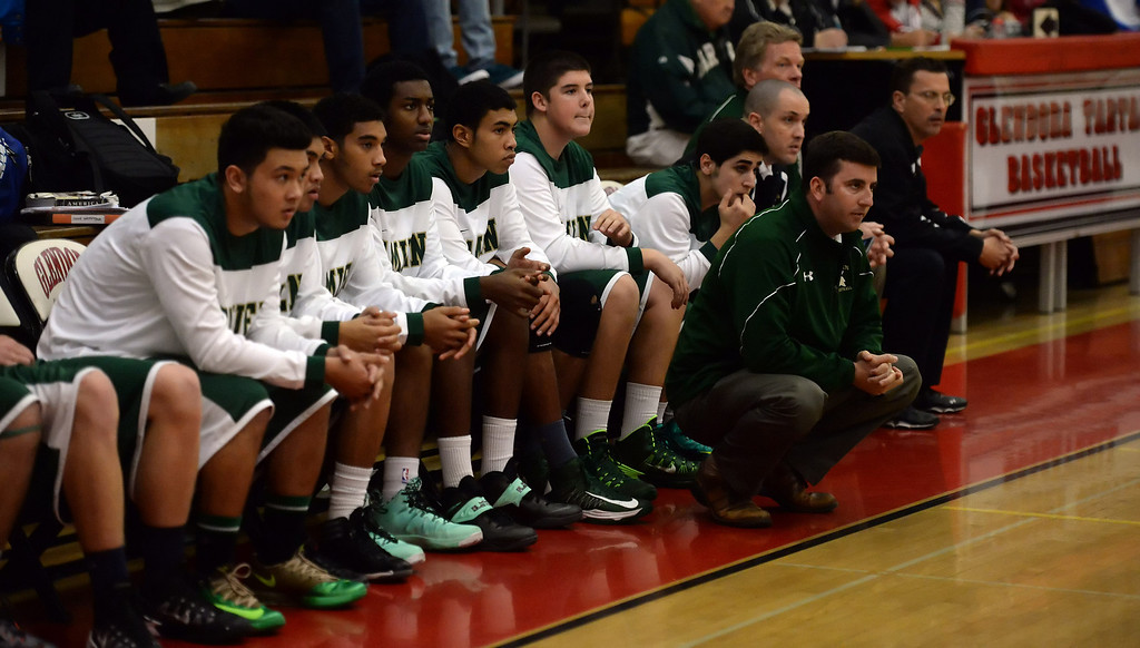 Description of . Damien bench in the second half of the Glendora basketball tournament against Walnut at Glendora High School in Glendora, Calif., on Friday, Dec. 13, 2013. Damien won 66-60.  (Keith Birmingham Pasadena Star-News)