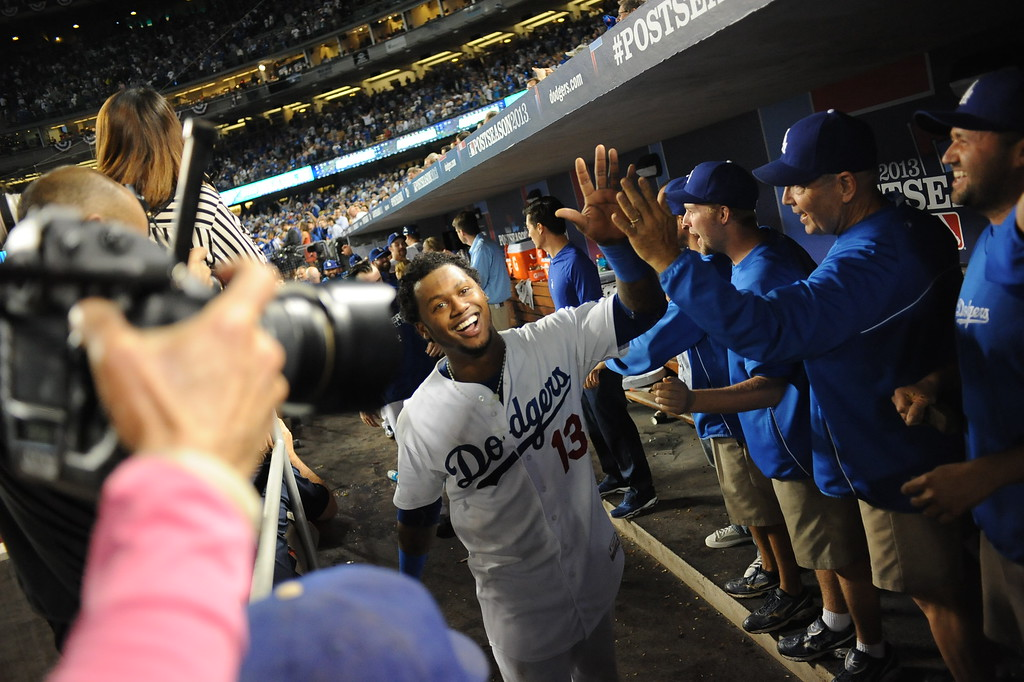 Description of . Dodger's Hanley Ramirez celebrates the Dogers' win over Atlanta Monday, October 7, 2013 ( Photo by Andy Holzman/Los Angeles Daily News )