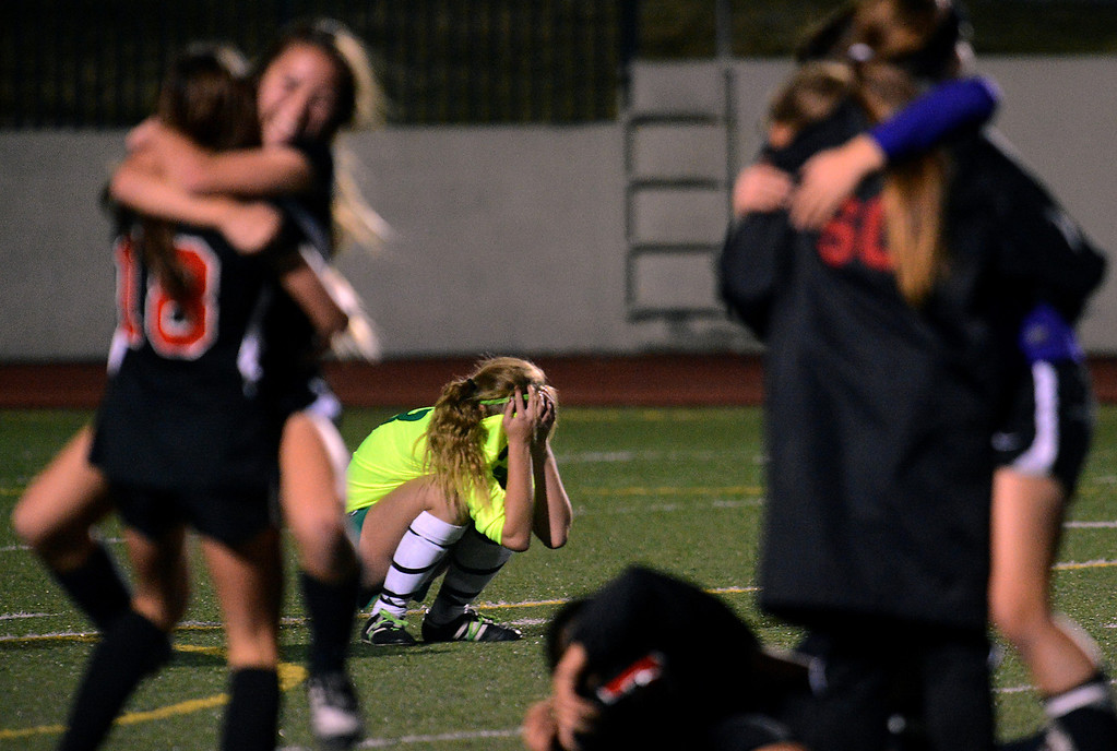 Description of . Upland's McKenna Pigoni reacts after San Clemente gets the golden goal to advance in the CIF-SS Division 1 playoffs Thursday, February 14, 2013, at Upland High School in Upland. Upland was eliminated by San Clemente 1-0 in overtime.(Staff photo by Jennifer Cappuccio Maher)