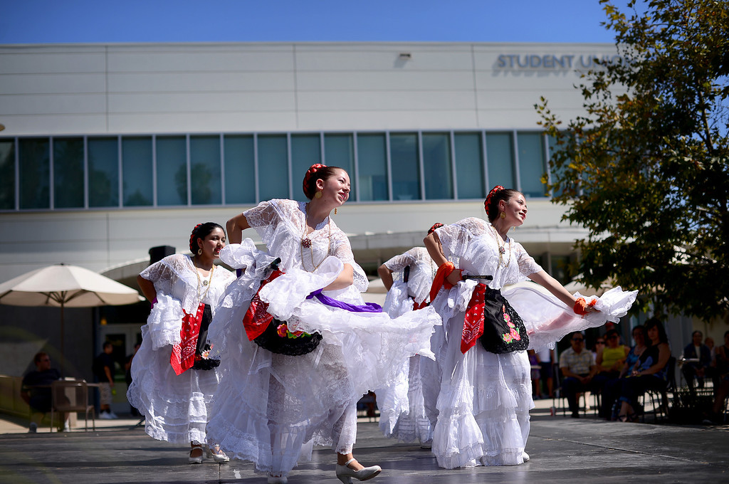 Description of . Plaza de la Raza's Youth Mariachi and Ballet Folklorico perform at Rio Hondo College's Latino Heritage Month's kickoff celebration Saturday, September 14, 2013 at the Whittier college's quad. (Photo by Sarah Reingewirtz/Pasadena Star-News)