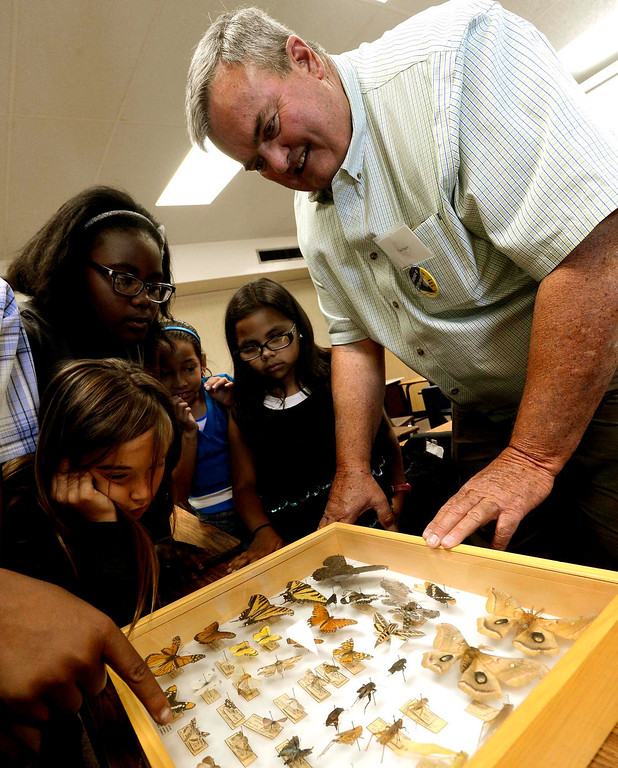 Description of . Entomologist Tim Hayes shows students a box of insects and butterflies during the final day of the 19th Annual Career Awareness Week at Lankershim Elementary School in Highland June 6, 2013.  GABRIEL LUIS ACOSTA/STAFF PHOTOGRAPHER.