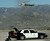 LAPD Special Weapons and Tactics members gather at Redlands Airport as police move in on Christopher Dorner in the Big Bear area February 12, 2013.  (Thomas R. Cordova/Staff Photographer)