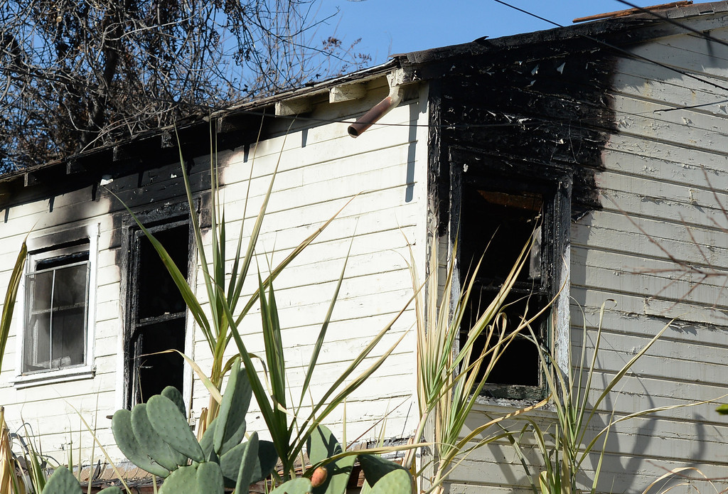 Description of . Whittier Police officers investigate a house fire on the 13500-block of Via Del Palma in Whittier Where two residents were found dead inside on Thursday January 2, 2014. (Staff Photo by Keith Durflinger/Whittier Daily News)