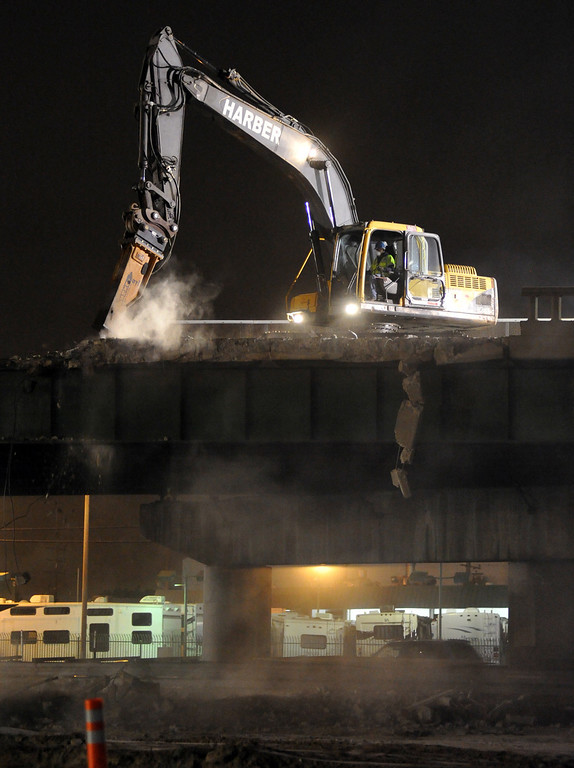 Description of . Caltrans and contractors work to demolish the Alondra Bridge over the Santa Ana (I-5) Freeway early Saturday morning June 15, 2013. Traffic was closed on the northbound lanes as the surface of that side of the bridge is removed. The northbound steel girders are expected to be removed Sunday. (SGVN/Staff Photo by Keith Durflinger)