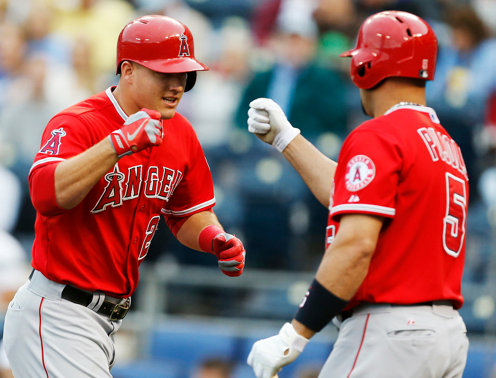 Description of . Los Angeles Angels\' Mike Trout (27) fist bumps with teammate Albert Pujols (5) after his solo home run in the first inning of a baseball game against the Kansas City Royals at Kauffman Stadium in Kansas City, Mo., Thursday, May 23, 2013. (AP Photo/Orlin Wagner)