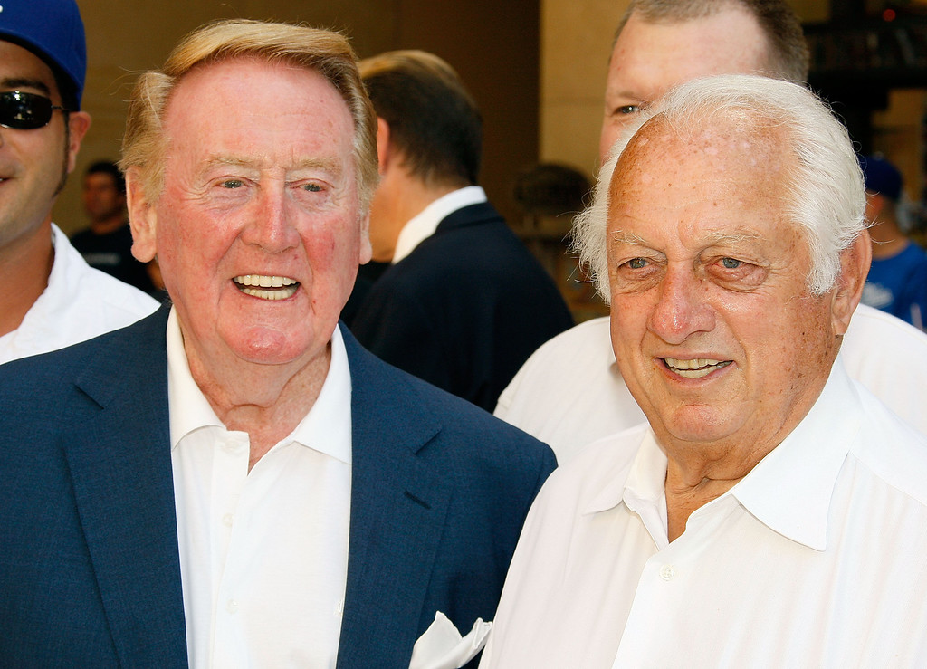 Description of . HOLLYWOOD - JUNE 20:  Dodgers radio announcer Vin Scully and former manager Tommy Lasorda attend a special star ceremony honoring the Los Angeles Dodgers with an Award of Excellence on the Hollywood Walk of Fame on June 20, 2008 in Hollywood, California. (Photo by Vince Bucci/Getty Images)