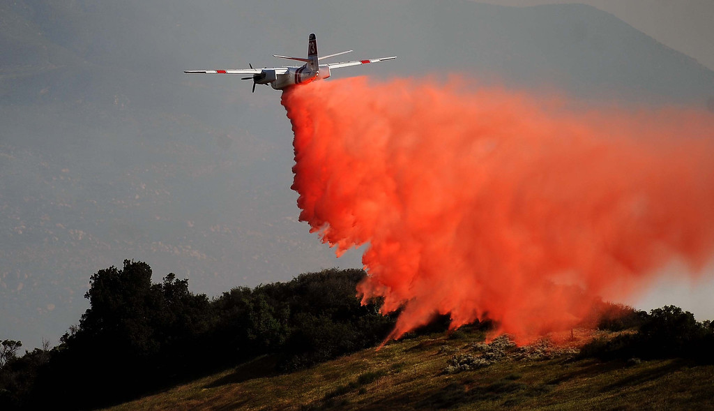 Description of . An air tanker drops fire retardant on a 1,500 acre brush fire Wednesday May 1, 2013 in Banning. LaFonzo Carter/Staff Photographer