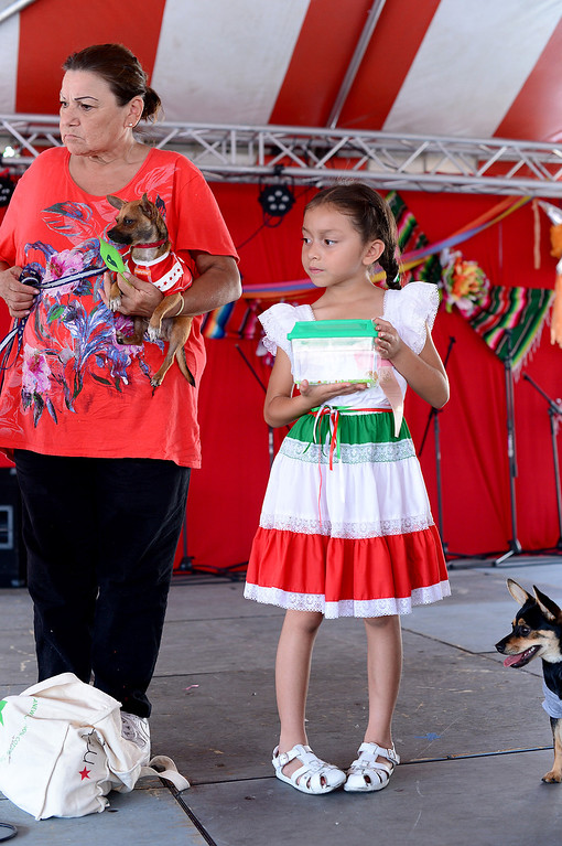 Description of . The San Gabriel Mission holds their annual Children and Pet Costume Contest and a Blessing of the Animals during their 242nd Annual La Fiesta de San Gabriel Saturday, August 31, 2013. The fiesta runs through Sunday. (Photo by Sarah Reingewirtz/Pasadena Star-News)
