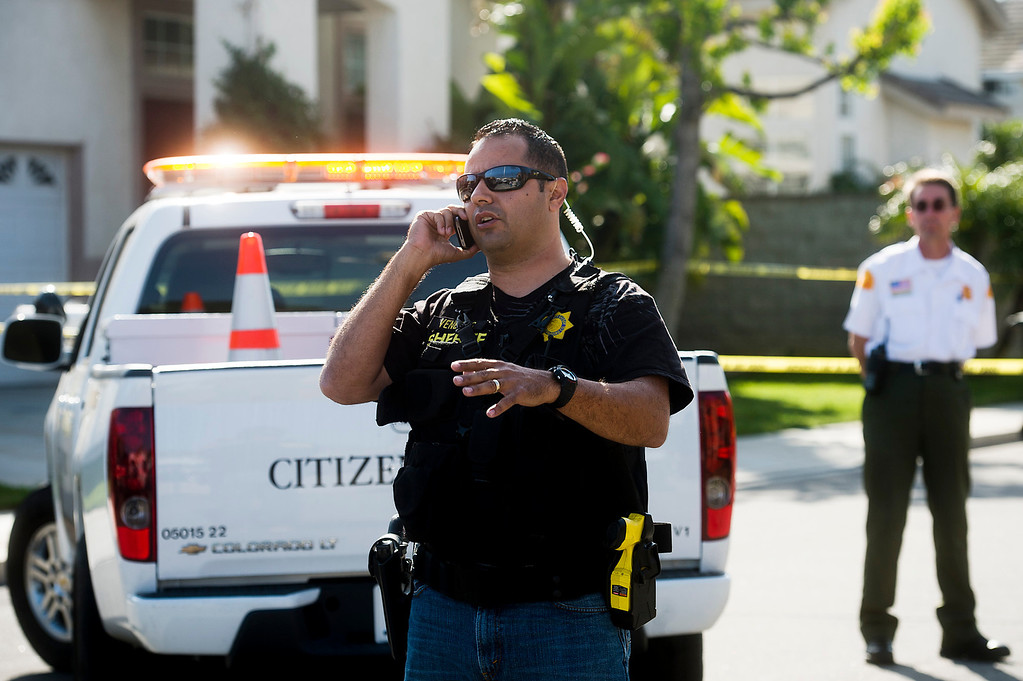 Description of . San Bernardino County Sgt. Jesse Dengas at the scene of a deputy-involved shooting at the 5400 block of Brushwood Court in Chino Hills on Friday, March 28, 2014. (Photo by Watchara Phomicinda/ San Gabriel Valley Tribune)