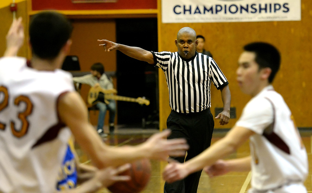 Description of . The official keeps an eye on the game in the first half of a prep basketball game between San Dimas and Wilson at Wilson High School in Hacienda Heights, Calif., on Friday, Jan. 31, 2014. (Keith Birmingham Pasadena Star-News)