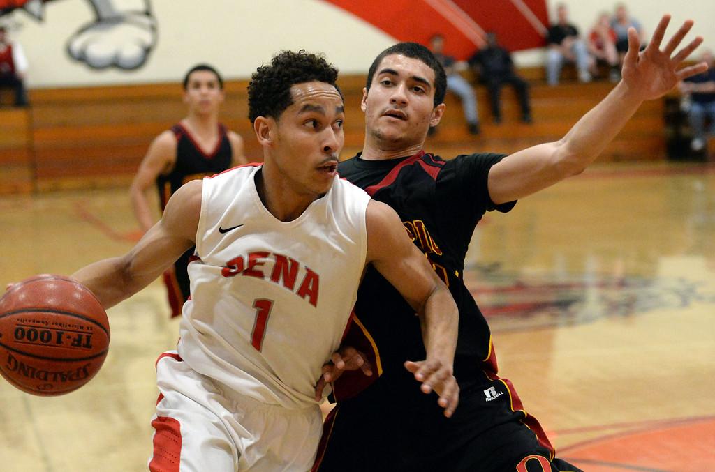 Description of . Pasadena's Ajon Efferson (1) drives to the basket against Ontario in the first half of a prep playoff game at Pasadena High School in Pasadena, Calif., on Friday, Feb.21, 2014. (Keith Birmingham Pasadena Star-News)