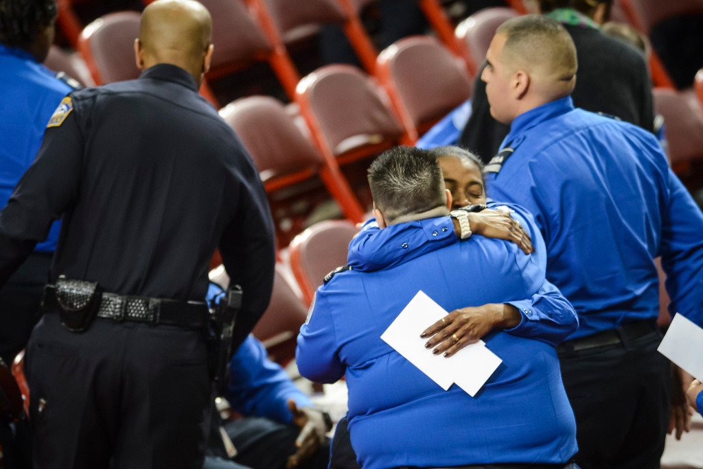 Description of . TSA officer hug at the memorial for slain TSA officer Gerardo Hernandez at the Los Angeles Sports Arena Tuesday, November 12, 2013.  A public memorial was held for Officer Hernandez who was killed at LAX when a gunman entered terminal 3 and opened fire with a semi-automatic rifle, Grigsby was wounded in the attack.  ( Photo by David Crane/Los Angeles Daily News )
