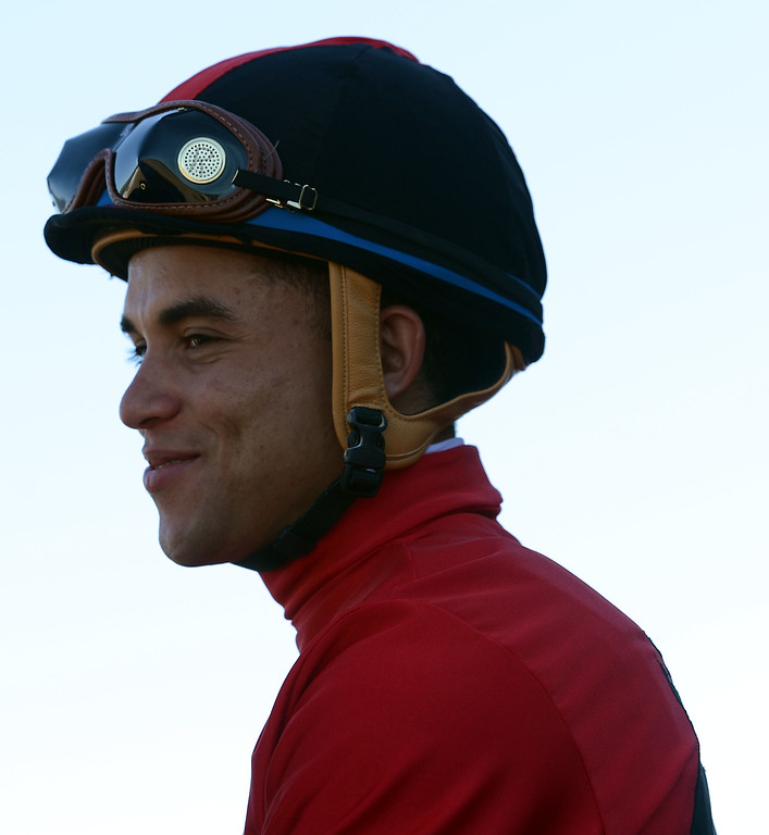 Description of . Jockey Joel Rosario atop