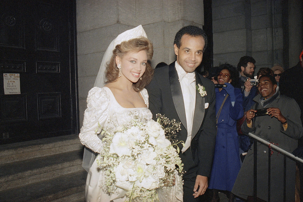Description of . Former Miss America Vanessa Williams poses with Ramon Hervey, on the steps of St. Francis Xavier Church in Manhattan, New York City, Saturday, Jan. 3, 1987. Hervey was the man hired to help manage her career during the controversy that forced her to relinquish her title in 1984. (AP Photo/D. Bookstaver)