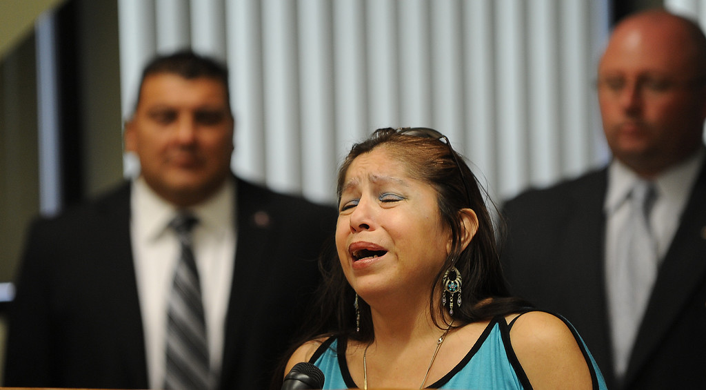 Description of . Rosie Curonilla,left, mother of Daniel Olivera speaks to the media about her son death during a press conference at the San Bernardino County Sheriff's Headquarters Thursday August 22, 2013 in San Bernardino. Daniel Olivera 26, of Hesperia was shot and killed at the AM/PM Arco convenience store on August 11, 2013 in Victorville.LaFonzo Carter/Staff Photographer