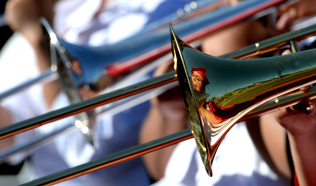 Description of . A graduate plays in the band during the Whittier High School graduation at Whittier College in Whittier, Calif., on Wednesday, June 4, 2014.  (Keith Birmingham/Pasadena Star-News)