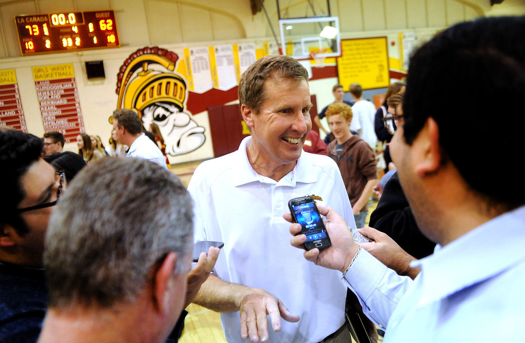 Description of . La Canada head coach Tom Hofman talks with reporters after winning his 600th game as they defeated La Salle 73-62 during a prep basketball game at La Canada High School in La Canada, Calif., on Friday, Jan. 10, 2014. Hofman record is 600 wins and 186 losses since becoming varsity head coach in the 1986-87 season. (Keith Birmingham Pasadena Star-News)