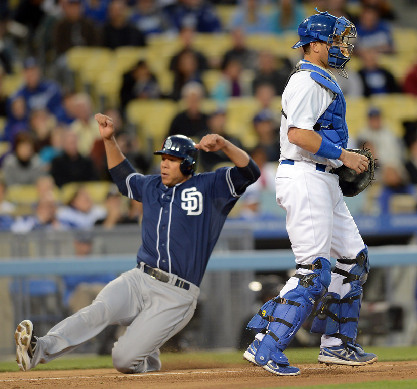 Description of . One of four 1st inning runs scores behind Dodger catcher A.J. Ellis at Dodger Stadium Tuesday April 16, 2013. The Padres defeated the Dodgers 9-2.  (Andy Holzman/Los Angeles Daily News)