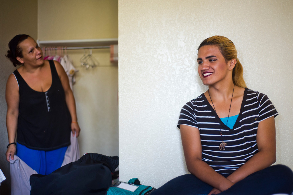 Description of . Patrick Cordova, 15, right, receives an advice from his mom, Angelica Cordova, while getting ready for his day at a Motel 6 where his family is living in El Monte, Calif. on Thursday, Sept. 6, 2013. Cordova is a transgender senior at Azusa High who was voted in the top 5 for homecoming queen. (Photo by Watchara Phomicinda/ San Gabriel Valley Tribune)