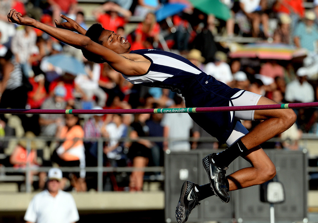 Description of . Redlands' Jahvad McDerrmott competes in the high jump during the CIF-SS Masters Track and Field meet at Falcon Field on the campus of Cerritos College in Norwalk, Calif., on Friday, May 30, 2014.   (Keith Birmingham/Pasadena Star-News)