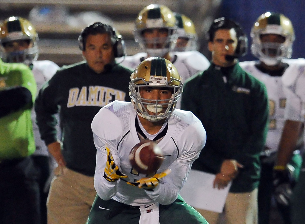 Description of . Damien's Mackenzie Sternquist catches a pass in the first half of a prep football game against Charter Oak at Charter Oak High School in Covina, Calif., Friday, Oct. 11, 2013.    (Keith Birmingham Pasadena Star-News)