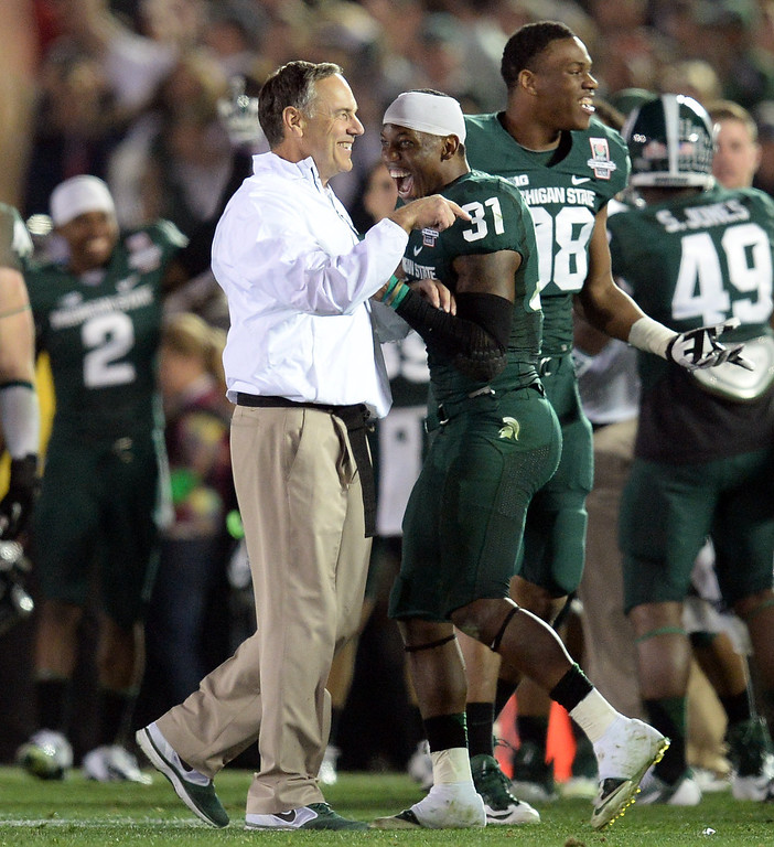 Description of . Michigan State head coach Mark Dantonio and Darqueze Dennard #31 are all smiles as time expires during the 100th Rose Bowl game in Pasadena Wednesday, January 1, 2014. Michigan State defeated Stanford 24-20. (Photo by Hans Gutknecht/Los Angeles Daily News)