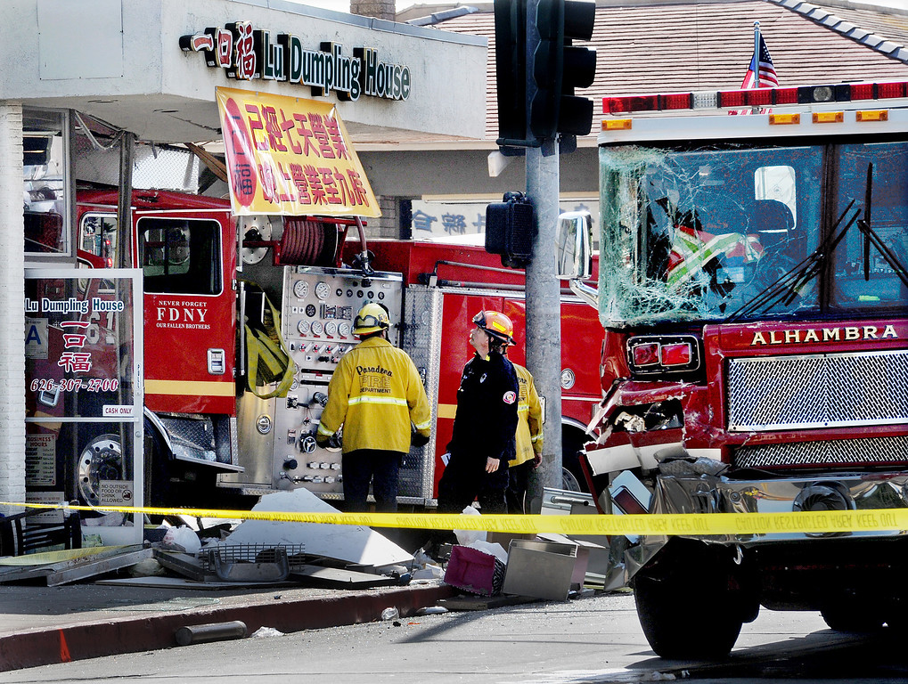 Description of . An Alhambra Fire ladder truck and Monterey Park Fire truck collided in the intersection of Garfield Avenue and Emerson Avenue Wednesday April 16 2014. The Monterey Park Fire engine drove into a Chinese restaurant. One civilian is in critical condition,  one firefighter with moderate injuries, and five firefighters with minor injuries, and  eight civilians with minor injuries.(Photo by Walt Mancini/Pasadena Star-News)