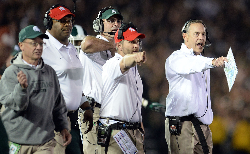 Description of . Michigan State head coach Mark Dantonio, right, reacts after a penalty on Stanford in the second half of the 100th Rose bowl game in Pasadena, Calif., on Wednesday, Jan.1, 2014. Michigan State won 24-20.