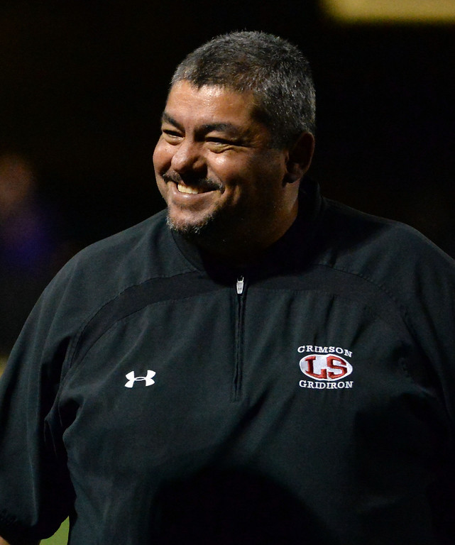 Description of . La Serna head coach Margarito Beltran is all smiles after a touchdown by Bryce Oliver (not pictured) in the first half of a CIF-SS playoff football game against Diamond Bar at Diamond Bar High School in Diamond Bar, Calif., on Friday, Nov. 22, 2013.   (Keith Birmingham Pasadena Star-News)