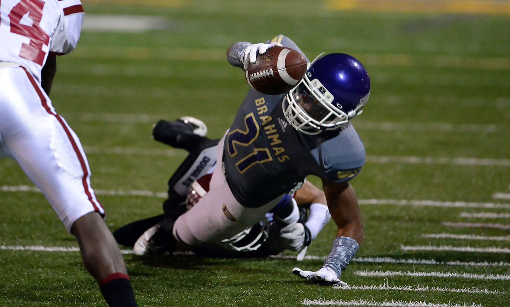 Description of . Diamond Bar's Cordell Broadus dives for a first down against La Serna in the first half of a CIF-SS playoff football game at Diamond Bar High School in Diamond Bar, Calif., on Friday, Nov. 22, 2013.   (Keith Birmingham Pasadena Star-News)