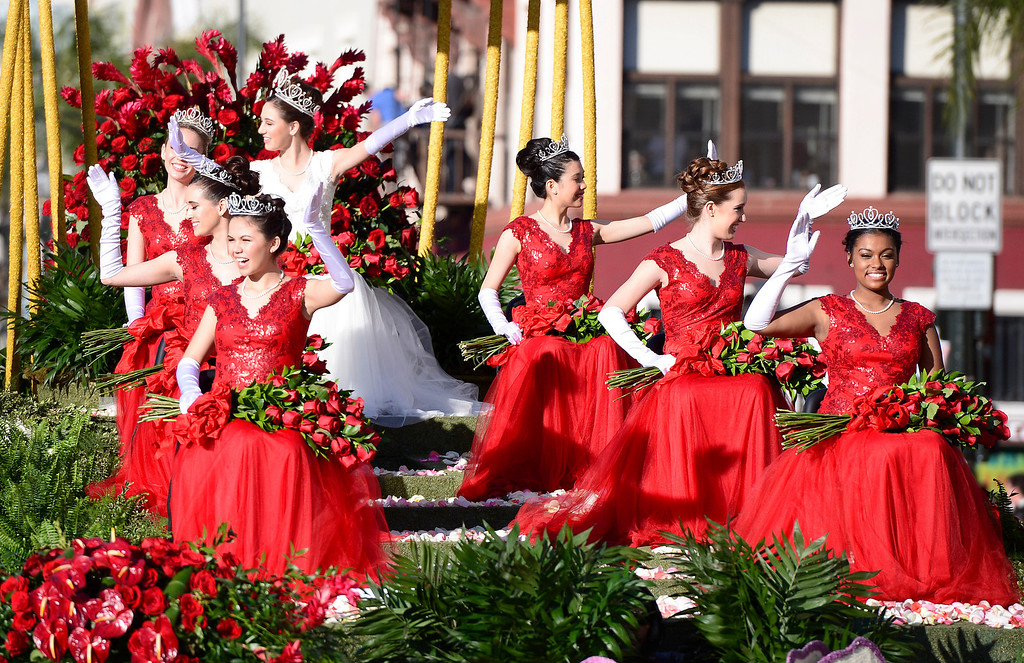 Description of . Rose Queen Ana Marie Acosta and her court ride in the Macy's float as it heads down Colorado Boulevard during the 125th Rose Parade in Pasadena, CA January 1, 2014. (Photo by Sarah Reingewirtz/Pasadena Star-News)