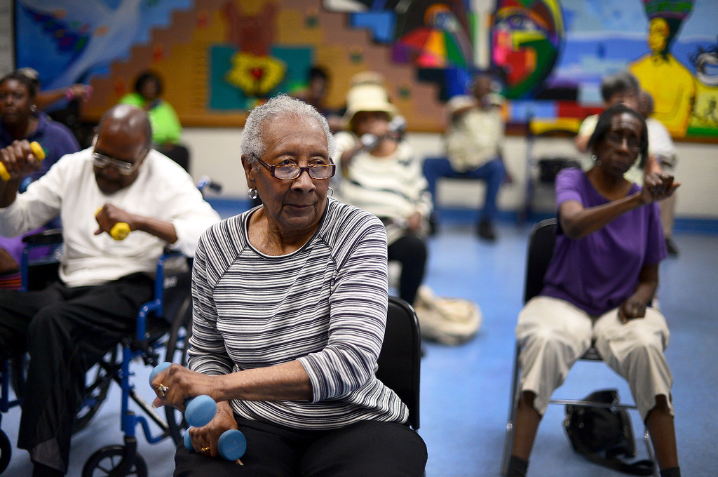 Description of . Retired school teacher Charlene Edson, 83, center, takes a chair aerobics class with other seniors taught by Annie Louise