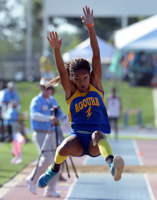 Description of . Agoura's Tara Davis competes in the during long jump CIF California State Track & Field Championships at Veteran's Memorial Stadium on the campus of Buchanan High School in Clovis, Calif., on Saturday, June 7, 2014. 