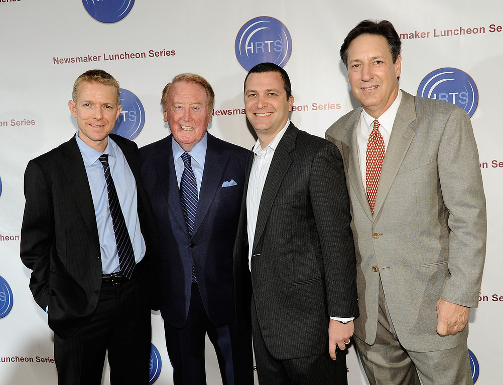 Description of . BEVERLY HILLS, CA - NOVEMBER 10:  (L-R) Kevin Beggs, HRTS President, Voice of the Los Angeles Dodgers Vin Scully, producer Jordan Levin and Andy Friendly attend the Hollywood Radio & Television Society Newsmaker Lunheon at the Beverly Wilshire Hotel  on November 10, 2009 in Beverly Hills, California.  (Photo by Michael Buckner/Getty Images)