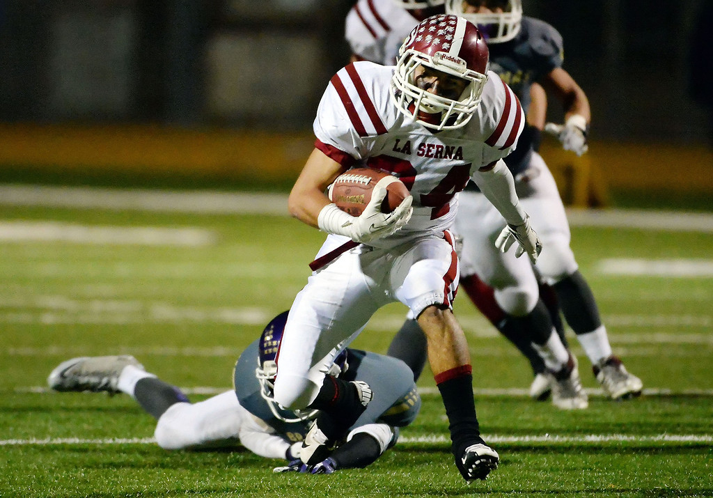 Description of . La Serna's Anthony Garcia (24) runs past Diamond Bar's Chris Torres for a first down in the first half of a CIF-SS playoff football game at Diamond Bar High School in Diamond Bar, Calif., on Friday, Nov. 22, 2013.   (Keith Birmingham Pasadena Star-News)
