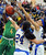 \tp4n\ drives to the basket against Bishop Amat's Jennifer Vasquez (24) in the first half of a CIF State Southern California Regional semifinal basketball game at Bishop Amat High School on Tuesday, March 12, 2013 in La Puente, Calif. Long Beach Poly won 52-34. 