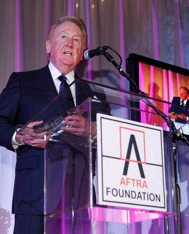 Description of . OS ANGELES, CA - MARCH 09: Los Angeles Dodger announcer Vin Scully speaks during the 2009 AFTRA Media and Entertainment Excellence Awards at the Biltmore Hotel on March 9, 2009 in Los Angeles, California. (Photo by Michael Buckner/Getty Images)
