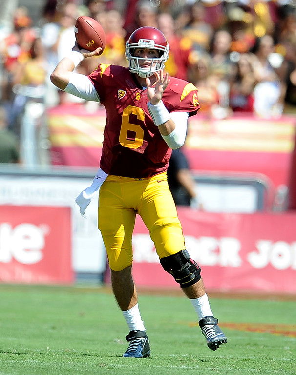 Description of . Southern California quarterback Cody Kessler passes against Boston College during the second half of an NCAA college football game in the Los Angeles Memorial Coliseum in Los Angeles, on Saturday, Sept. 14, 2013. Southern California won 35-7. 