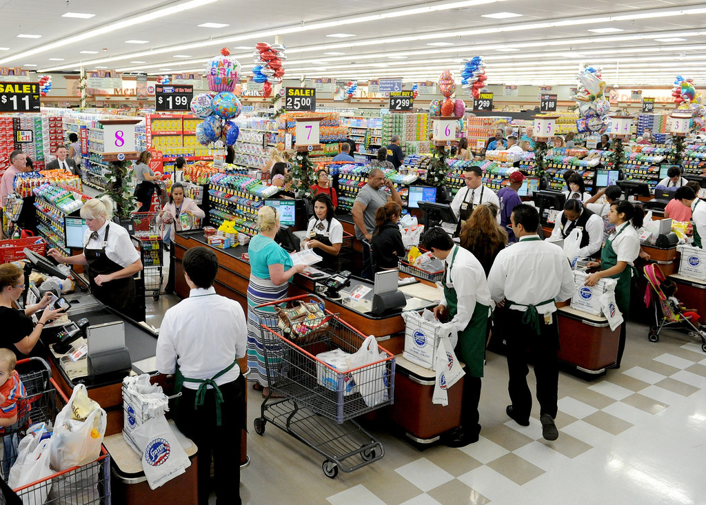 Description of . (John Valenzuela/Staff Photographer) Customers shop inside the new Stater Bros. in Redlands during the grand opening of the grocery store, Wednesday, September 25, 2013. The new store replaces the one directly across the street, offering more amenities and services, including a bakery, seafood counter and wider aisles.
