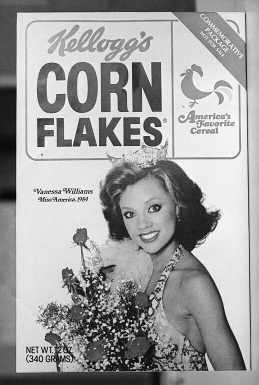 Description of . Packages of Kellogg's Corn Flakes with former Miss America Vanessa Williams on the front will not be distributed at the National Urban League convention in Cleveland. The commemorative edition photographed here was given out at the NAACP national convention in Kansas City, July 25, 1984. The back of the box carries a congratulatory statement to Miss Williams. (AP Photo/Cliff Schiappa)