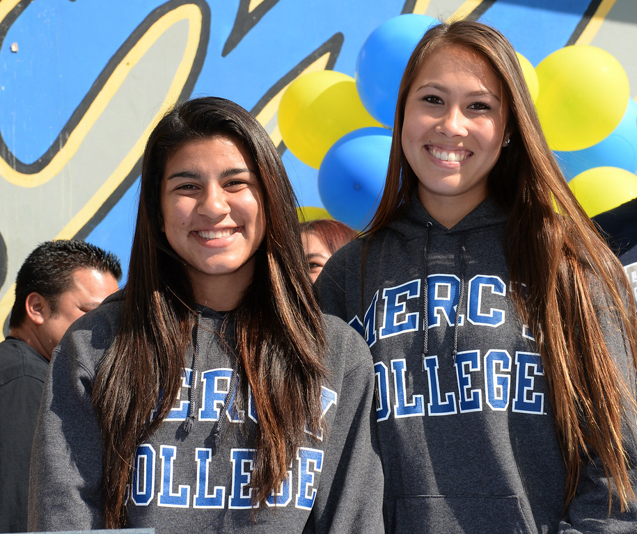 Description of . Girls Soccer players Ileen Mejia, left, and Samantha Scovel, after signing their letters of intent to attend Mercy College during National Signing Day at La Mirada High School on Wednesday February 5, 2014. (Staff Photo by Keith Durflinger/Whittier Daily News)