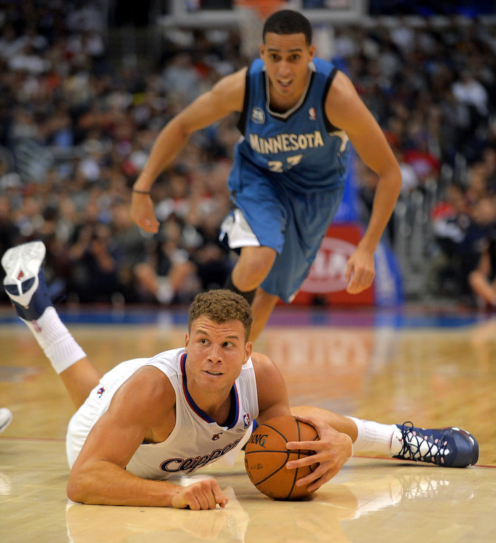 Description of . Los Angeles Clippers' Blake Griffin looks for help as puts up as Kevin Martin of the Minnesota Timberwolves approaches during the first half Monday, Nov. 11, 2013, in Los Angeles.(Andy Holzman/Los Angeles Daily News)