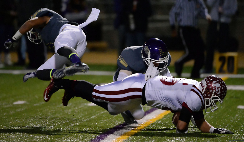Description of . La Serna's Luis Camacho (85) dives for a first down against Diamond Bar in the first half of a CIF-SS playoff football game at Diamond Bar High School in Diamond Bar, Calif., on Friday, Nov. 22, 2013.   (Keith Birmingham Pasadena Star-News)