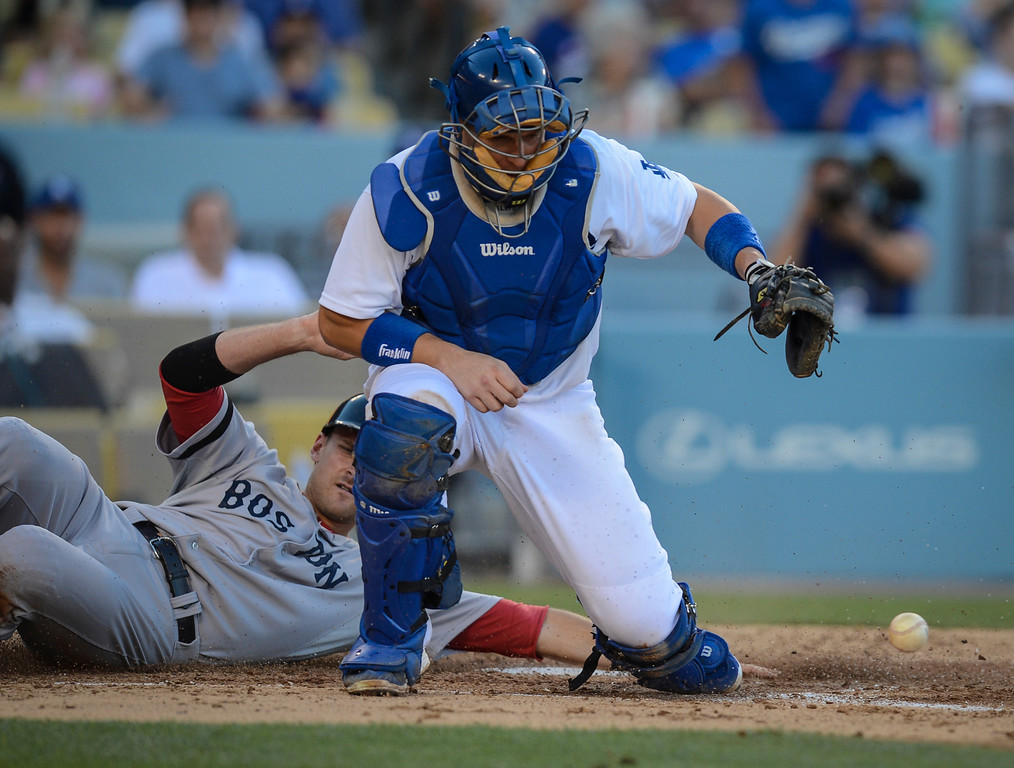Description of . Dodger's catcher A.J. Ellis can't get the ball as Boston's Will Middlebrooks scores during fourth inning action Sunday, August 25, 2013 at Dodger Stadium.  Red Sox won 8-1.  Photo by David Crane/Los Angeles Daily News.