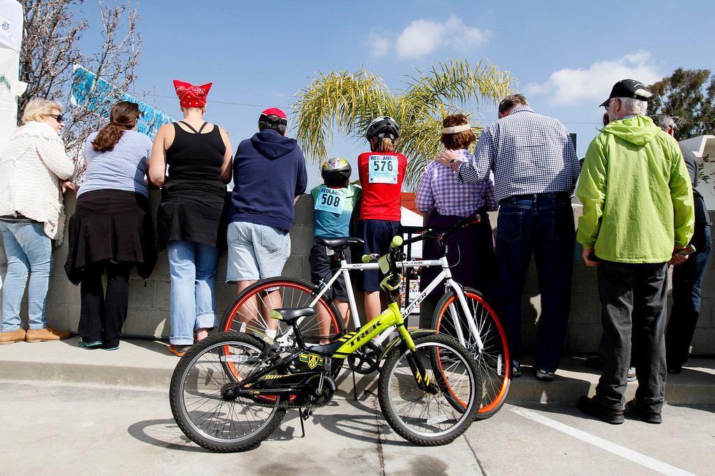 Description of . A crowd forms to watch the public race portion of the Redlands Bicycle Classic on Saturday, April 5, 2014 in Redlands, Ca. (Photo by Micah Escamilla for the Redlands Daily Facts)
